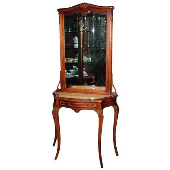 Beautiful antique 19th C. French walnut console/hall piece. This elagant antique features a beveled glass mirror, cabriolle legs, ormolu trim inlay and cream marble top.