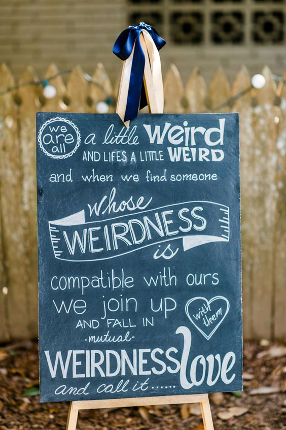 """We join up and fall in mutual weirdness and call it love,"" photo by Caroline Lima Photography http://ruffledblog.com/backyard-atlanta-wedding-with-burgundy-accents #weddingsigns #chalkboards"