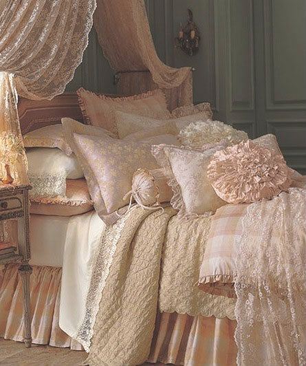 bedding done with layers of whites, creams and lots of texture.     Living Beautifully