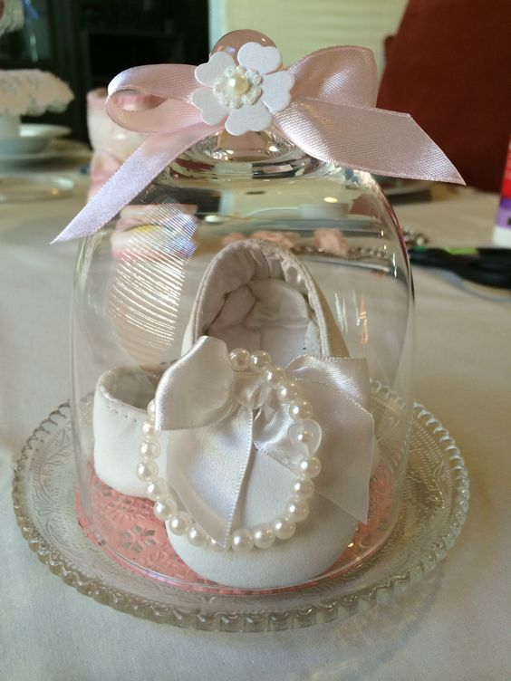 Baby shoes in a cloche.Pretty i do believe !