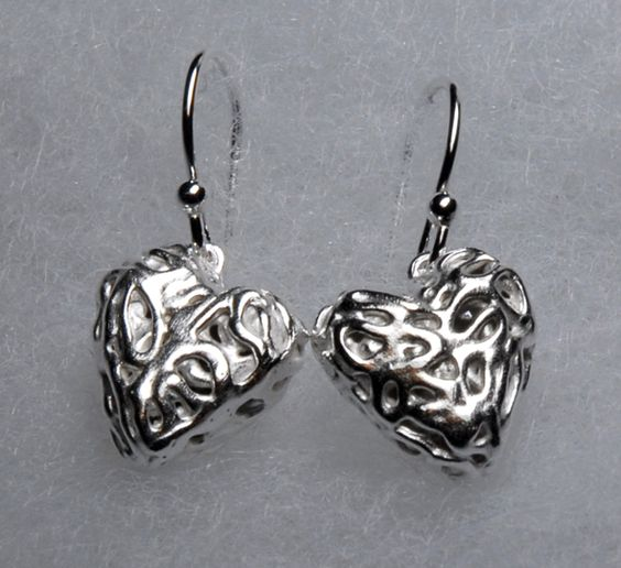 Some dainty little fine silver heart earrings. These are such fun to make but quite tough on the hands.