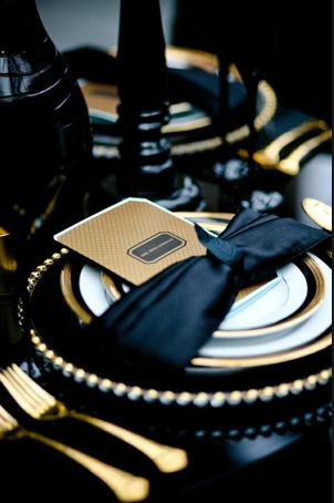 black and gold serrated glass dinnerwear | glass chargers with gold trim, topped with white plates with a black ...