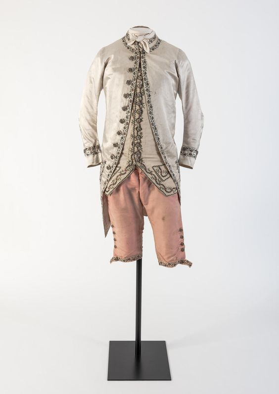 Man's cream silk satin embroidered coat and pink silk breeches, 1780's.