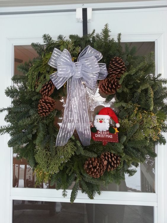 """Add your own Christmas ornament. This is a JanLar 28"""" mixed wreath."""