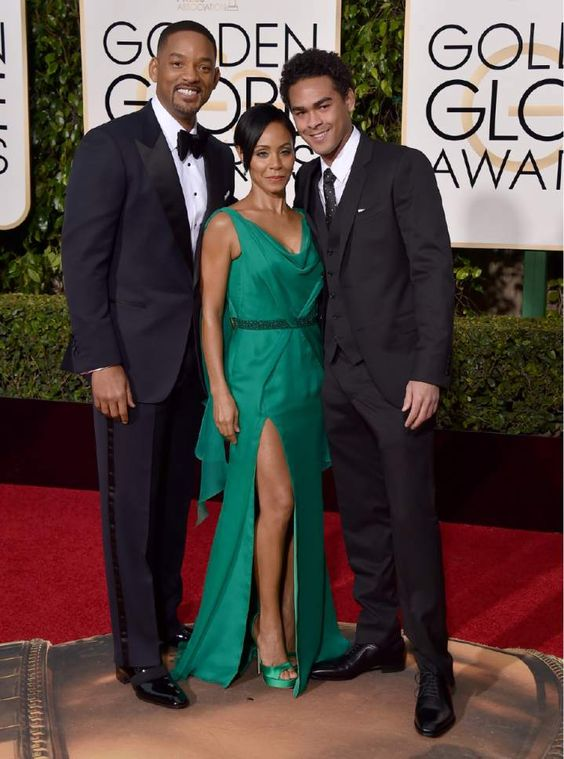 Will Smith, from left, Jada Pinkett Smith, and Trey Smith arrive at the 73rd annual Golden Globe Awards on Sunday, Jan. 10, 2016, at the Beverly Hilton Hotel in Beverly Hills, Calif. (Photo by Jordan Strauss/Invision/AP):