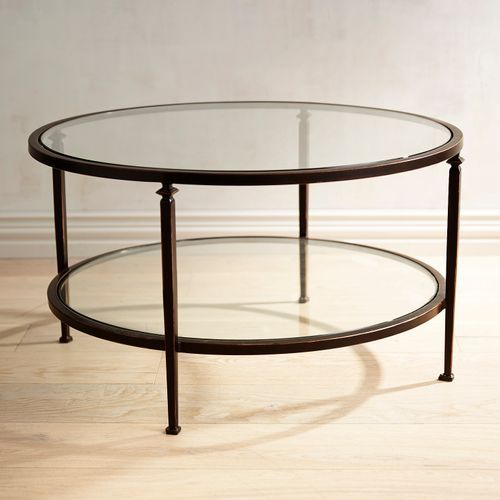 Our Lincoln Round Coffee Table Has A Slender Bronze Wrought Iron Frame And Clear Tempered Gl Mirrored Coffee Tables Metal Coffee Table Glass Top Coffee Table