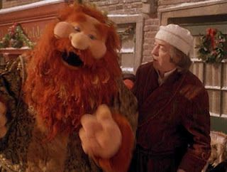 The ghost of Christmas Present & Scrooge (Michael Caine) in The Muppet Christmas Carol