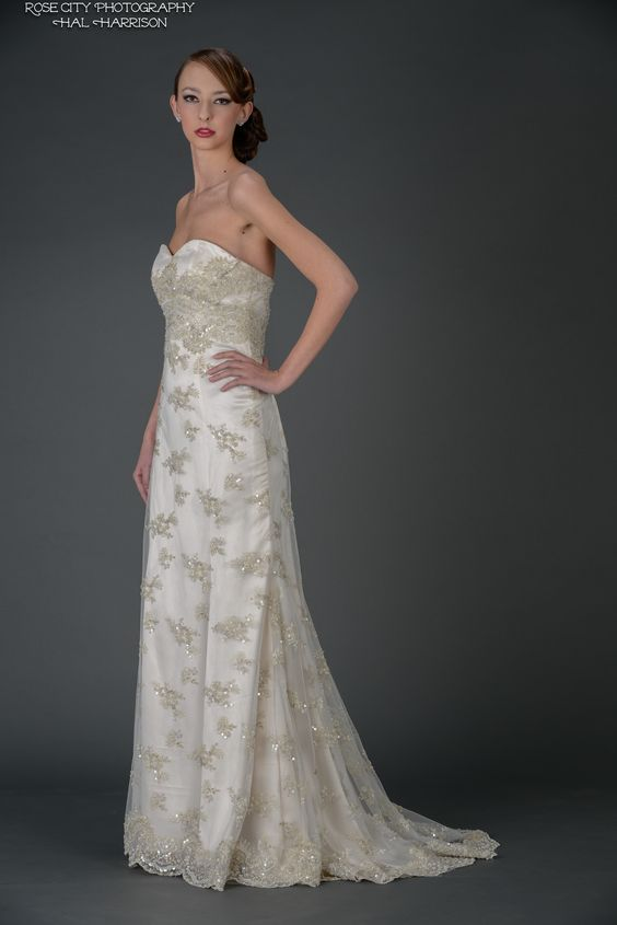 """Sparkle"" strapless gown with small train and embellished lace."