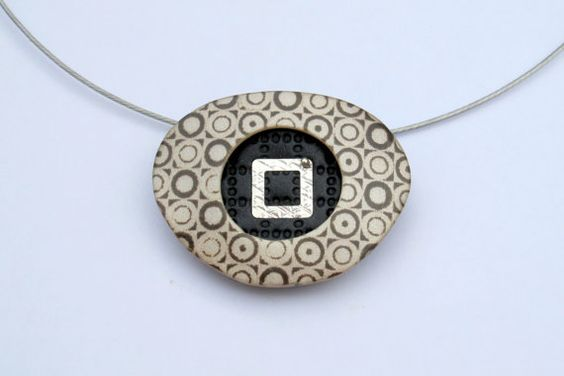 Cepia like retro print rounded triangle polymer clay pendant by OrlyFuchsGalchen