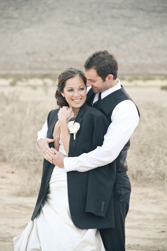 Love this photo bride wearing grooms jacket and he cuddling you too keep you warm xx