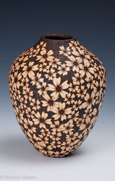 Michael Pryo    Soulshine.  turned from Bradford Pear and embellished with Pyrography. The petals of the flowers  were gently textured with a micro motor before the details were burned