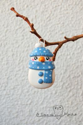 Snowman with blue bonnet and scarf. To brighten your christmas !