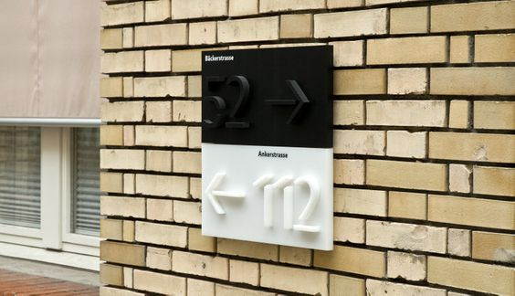 Signage for commercial buildings in Zurich using Jigsaw and Jigsaw Stencil. The type was cut into high-density polyethylene (PE-HD) using water jet cutter.