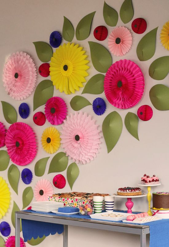We love this paper flower wall installation- it makes the dessert table look that much sweeter!