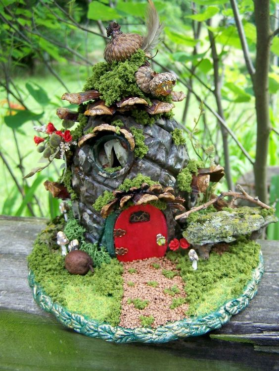 This fairy garden looks like it's portable. Just in case your fairy needs to relocate.