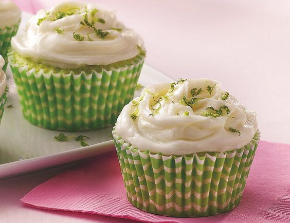 KEY LIME CUPCAKES!!!  INGREDIENTS:  Cupcakes:  1 box Betty Crocker® SuperMoist® lemon cake mix  1 box (4-serving size) lime-flavored gelatin  3/4 cup water  1/3 cup Key lime juice  1/3 cup vegetable oil  3 eggs  2 or 3 drops green food color, if desired    Glaze:  1 cup powdered sugar  2 to 2 1/2 tablespoons Key lime juice    Frosting:  1 package (8 oz) cream cheese, softened  1/4 cup butter or margarine, softened  1 teaspoon vanilla  3 1/2 cups powdered sugar  Grated lime peel, if desired    DIRECTIONS:    1. Heat oven to 350°F. Place paper baking cup in each of 24 regular-size muffin cups. In large bowl, beat cake mix and gelatin with electric mixer on low speed 30 seconds. Add remaining cupcake ingredients. Beat with electric mixer on low speed 30 seconds; beat on medium speed 2 minutes, scraping bowl as necessary. Divide batter evenly among muffin cups, filling each about 2/3 full.    2. Bake 17 to 22 minutes or until toothpick inserted in center comes out clean. Cool in pan 10 minutes. Remove from pan to cooling rack. With toothpick or wooden skewer, pierce tops of cupcakes in several places.    3. In small bowl, mix 1 cup powdered sugar and enough of the 2 to 2 1/2 tablespoons lime juice until glaze is smooth and thin enough to drizzle. Drizzle and spread glaze over cupcakes. Cool completely, about 30 minutes.    4. In large bowl, beat cream cheese and butter on medium speed until light and fluffy. On low speed, beat in vanilla and 3 1/2 cups powdered sugar until mixed; beat on medium speed until fluffy. Frost cupcakes, mounding and swirling frosting in center. Garnish with lime peel. Store covered in refrigerator.    Expert Tips:  You can use fresh or bottled Key lime juice. If Key lime juice is not available, use regular fresh or bottled lime juice.    Garnish each cupcake with a small piece of jellied lime candy slice instead of the lime peel.: Lemon Cake, Lime Juice, Cupcake Recipe, Cream Cheese, Cupcakes Recipe, Keylime Cupcake, Sweet Tooth, Key Lime Cupc