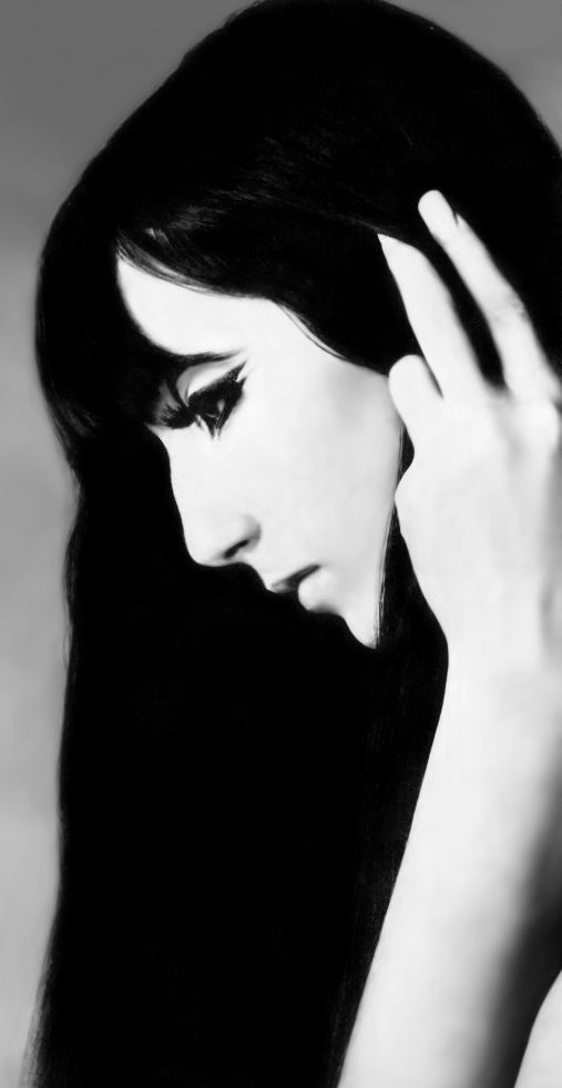 Contrasty portrait with the jet black hair and seamless white skin ... almost seems like graphic art ..