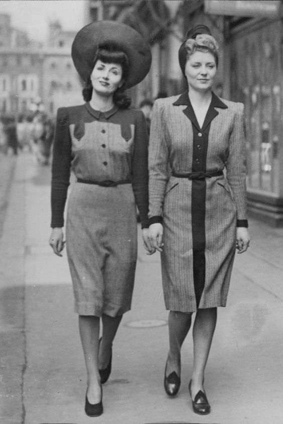 Models On Bond Street, London, 1942 The wartime look in Britain became much more austere as the years went by. This was the first collection of Utility Dresses for Women, designed by Norman Hartnell in 1942, and showcased on a very quiet Bond Street.