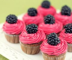 I think thease cupcakes are so cute with the fruit on the top and the colors are great together pink and dark purple/black :)