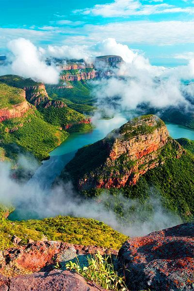 Blyde River Canyon in Mpumalanga, South Africa.  It is a 26 km long, 2500 deep canyon covered with vegetation, making it the largest green canyon in the world.