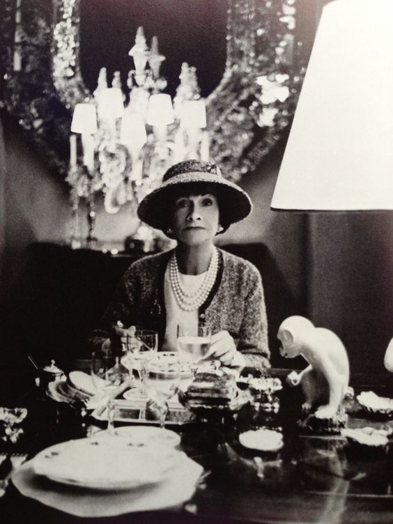 Gabrielle 'Coco' Chanel Dining at her apartment in Paris - Photo by Horst P. Horst (1963)