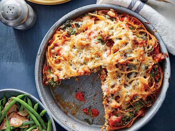 """Meet your new favorite casserole recipe. This budget-friendly dish (costing under $10) allows you to stretch a small amount of meat over several servings. It's family friendly, filling, and loaded with flavor--the perfect weeknight meal. The high heat on this recipe allows it to cook quickly, crisping the spaghetti slightly on the outside to make the perfect """"pie crust"""" for this dish. You can use crumbled sausage in this dish, or start with Italian sausage and remove the casing, which is…"""