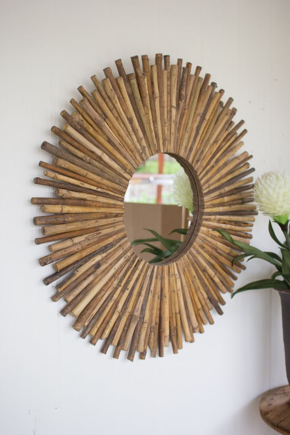 "We love the organic nature and textural interest of this great bamboo sunburst mirror! Bring a little outside into your home with this great piece! Product Description • Product Dimensions: 38.5"" D •"