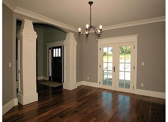 the white trim gray walls and dark wood floors love the