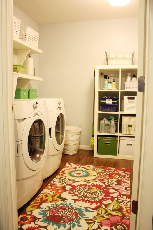 like the idea of a bright rug in the laundry room in front of the washer/dryer