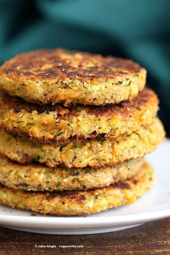 Carrot Zucchini Chickpea Fritters Patties - zucchini, carrots, garlic cloves, fresh ginger, green chili/cayenne, chickpeas, cumin seeds, coriander seeds, black peppercorns/ground pepper, ground cinnamon, ground cardamom, salt, flax/chia seed meal, oat/other flour (I bet chickpea flour would be great here!), breadcrumbs (optional, would omit), oil