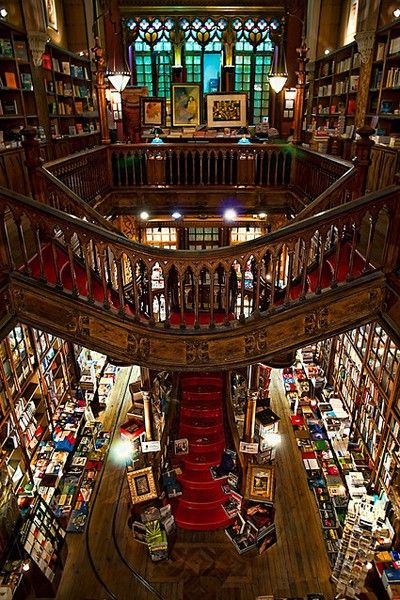 Great bookstore! Interior of Livraria Lello showing the iconic red staircase. Portugal.