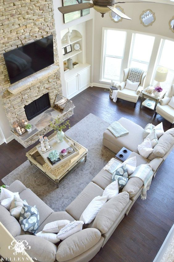 Two Story Living Room with stacked stone fireplace and built-ins Airy Elegant Living room