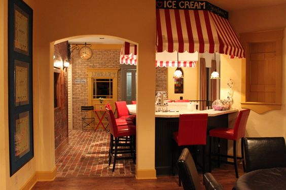 Coolest house ever. I would Love this to be my REAL kitchen, nevermind a playroom.  Super cute icecream bar,