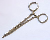 "Hemostat clamps with a smooth jaw make a great ""third hand"" for holding wire bundles together during wrapping!"