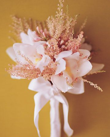 Simple  White Bouquet    Creamy Cymbidium Lionello spills out of a bridal bouquet accented by frothy astilbe and buds of society garlic, finished with white silk-satin ribbon.: Bridal Bouquets, Floral Design, Wedding Ideas, Wedding Bouquets, Satin Ribbons, Wedding Flowers, Cymbidium Lionello
