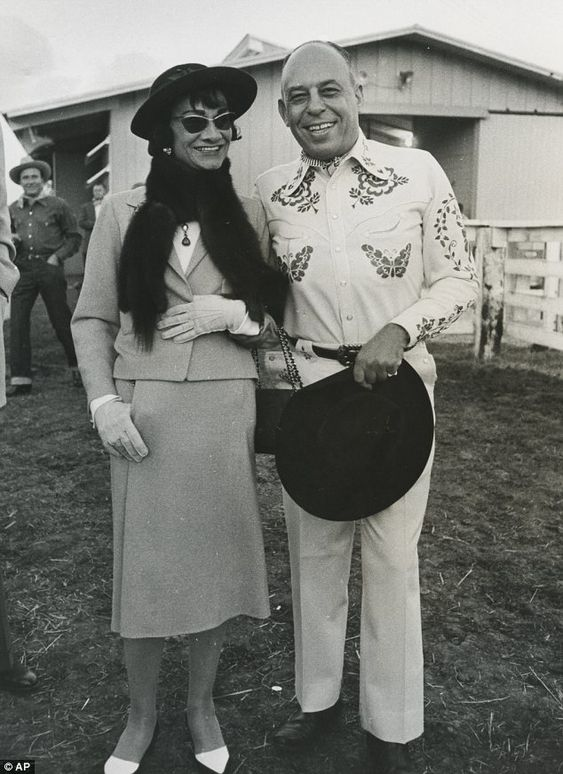 Coco Chanel and Stanley Marcus (leader of Dallas-based Neiman Marcus) at a Western party outside Dallas, 1957