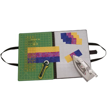 This would be so awesome in my small sewing space.  Omnigrid Fold-Away Portable Cutting & Pressing Station
