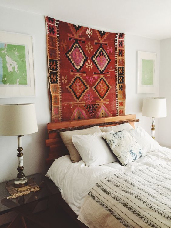 Transform a room by hanging a colorful Kilim rug on the wall above the bed or sofa: