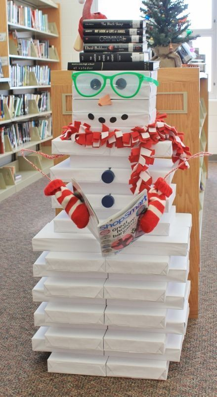 Searching for cheap Christmas decoration ideas? Try using reams of paper for a snowman's body, and giving him a hat made from books lying around your house--it's such an easy, cute Christmas craft!