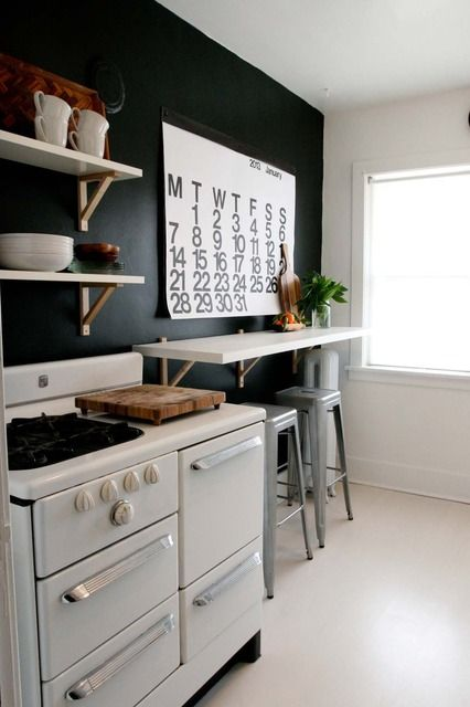 "Pinner says:It never occured to me to have a shelf along the wall on my sunporch with bar stools instead of a dining table. Levi can use the end for his drawing area. GENIUS | Kathryn & Perry's ""Have Less Do More"" Apartment House Tour:"