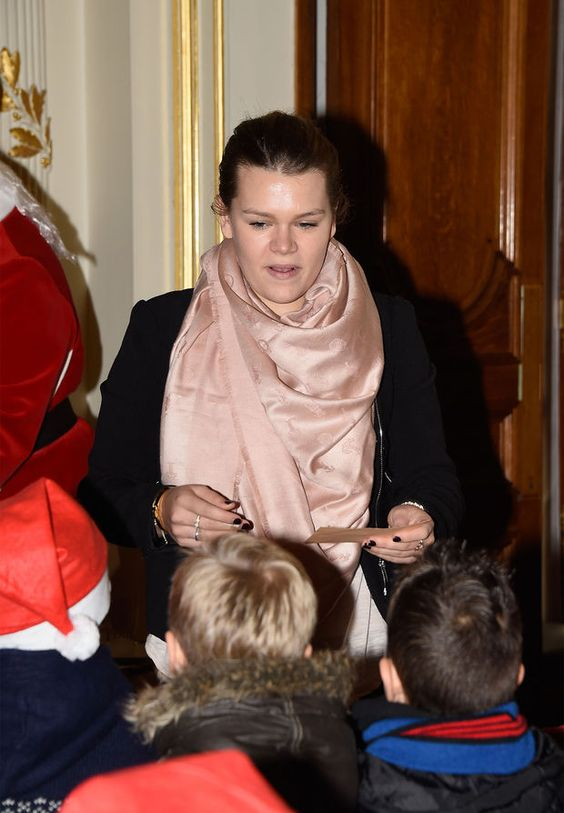December 17, 2014 - Camille handing out gifts in Monaco