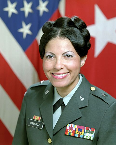 Sherian Grace Cadoria (b.1943) was the first African American female general in the United States Army and the highest ranking female at the time of her retirement in 1990 with the rank of Brigadier General. She is a graduate of Southern University in Baton Rouge, Louisiana, and holds a Master of Arts degree in Social Work from the University of Oklahoma. Initially in the Women's Army Corps, she transferred to the Military Police Corps in the 1970s.