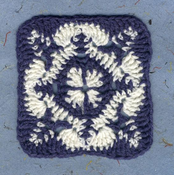 This is my design of a blue and white Granny Square, taking the pattern from a ceramic tile. In DK weight on it makes the square approximately 5 inches or 12 1/2 cm each side.