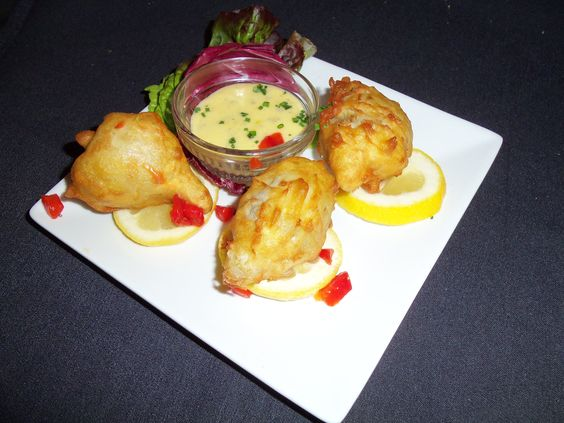 Artichoke Fritters stuffed with Blue Crab,  served with a Béarnaise sauce $8.50  #TheVeranda #DowntownFortMyers #SouthwestFlorida #FortMyers #finedining #southerncuisine #food #appetizers #ArtichokeFritters