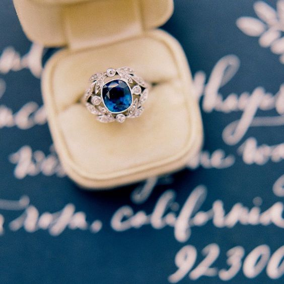 Magnificent Edwardian Era Engagement Ring with Stunning Sapphire and Diamond Laurel Wreath Frame