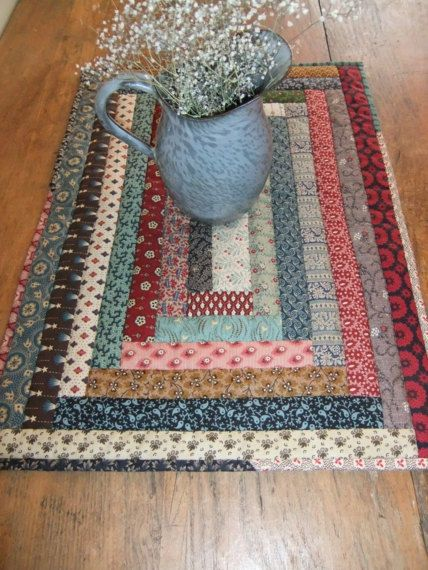 This primitive quilted table topper mat is a unique scrappy quilt of my own design. I just love how it turned out. It would wonderful for any