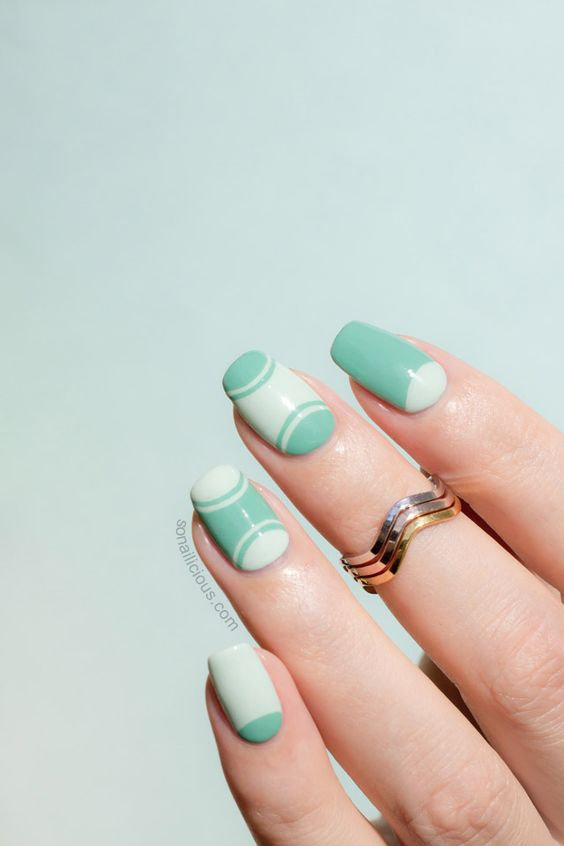 Mint half moon manicure HOW-TO: http://sonailicious.com/outlined-half-moon-manicure-tutorial/