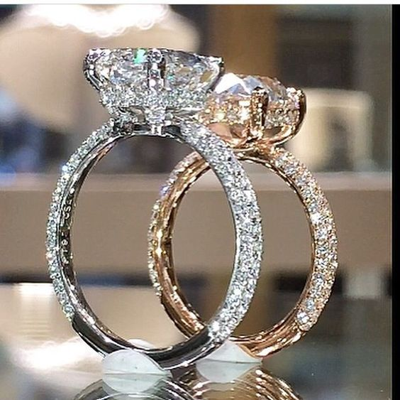 Yeessssss!!! The diamond band underneath the stone (instead of a halo!!)!!! And diamonds up the prongs PLUS micropave!? Only thing I'd change is add a prong or two - don't like how 4 prongs makes a round diamond look square. I like round :)