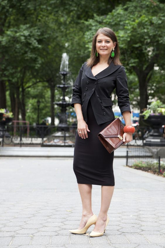 Spotted in Madison Square Park. Victoria Mukovozov, VP at a Financial Firm. Victoria is wearing a Victorine by Victorine Deych dress, Amrita Singh earrings, Ted Rossi bracelet, Elizabeth and James blazer and vintage bag and shoes. Victoria describes her personal style as wearing things that convert easily from day to night. Her dress, which doubles as a pencil skirt under her blazer during the day, actually has intricate detailing on the part hidden under the blazer, which shows sans blazer…