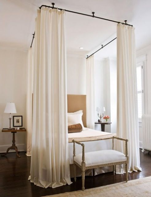 Romantic white bedroom with French bench at end of bed and curtains. Romantic European Farmhouse Bedroom Decor Ideas!